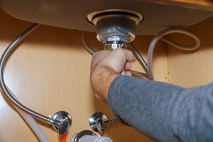 plumber-install-a-sink-in-kitchen-of-plu