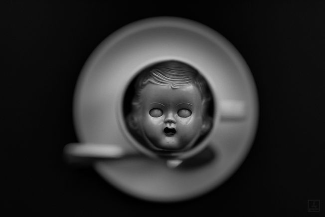 "antique dollhead in ""the cup"" I photograph on my travels around the world"