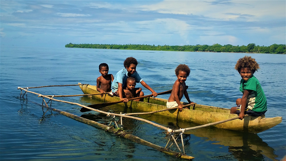 Kids have a time out on their canoe, Panaeati Island