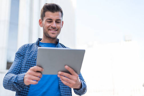 2175056-young-man-happy-with-a-tablet-on