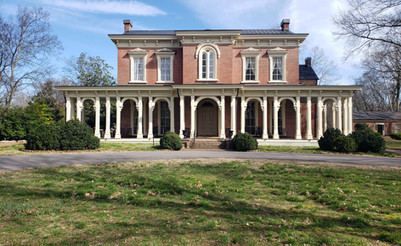 The front portion of Oakland's Mansion was designed by the architect Samuel Richard Sanders. The arches, door front, and windows were all completed by enslaved workers.