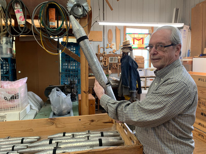 Dennis Milnar organizes some of the smaller pipes used in organs that his company is hired to refurbish.