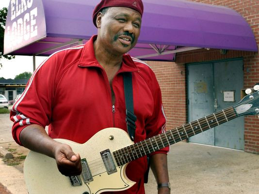 """Johnny Jones a local blues legend said, """"its the man not the guitar,"""" while standing in front of the Elks Lodge which used to be Club Baron where he played years ago on Jefferson Ave. Aug. 13, 2003. (Photo by Leah L. Jones)"""