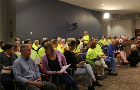 """Residents of the Cason Lane area attend the Planning Commission meeting, many wearing shirts that say, """"Save the Cason Lane Trailhead Greenway."""""""