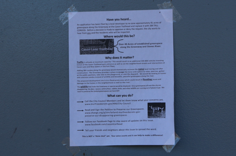 A sign posted on the bathroom door at Cason Trailhead detailing what the project is and what residents can do to stop it.