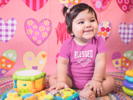Mockup of a very happy baby girl sitting