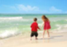 Children playing on Vanderbilt Beach in Naples, FL