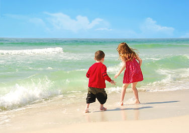 Children playing on Vanderbilt Beach in Naples, FL