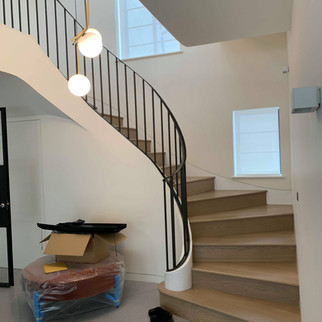 Curved oak treads / metal handrail and balastrades