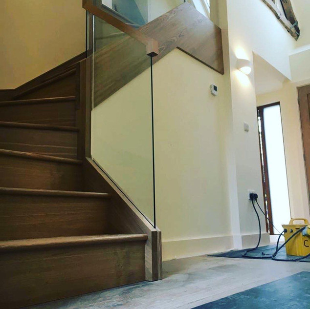 Oak and glass let into stairs