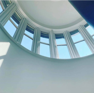 Curved solid finnished windows