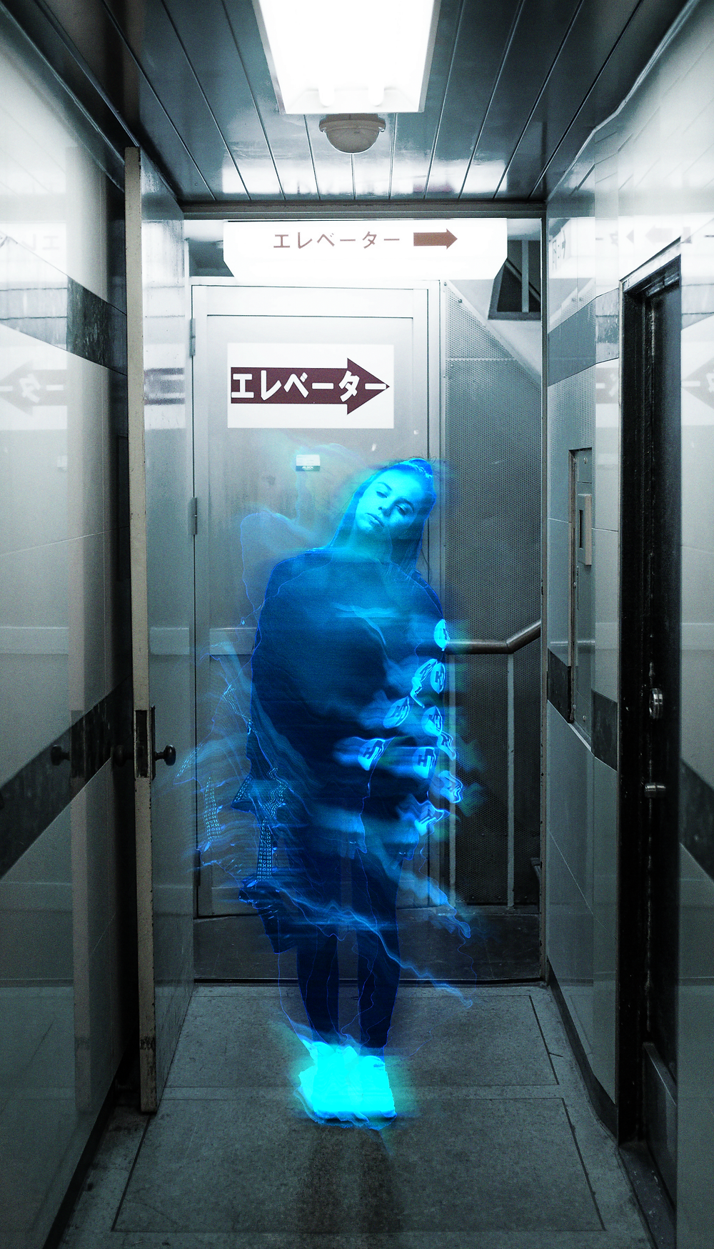 A girl appears as a blue ghost in a desaturated hallway