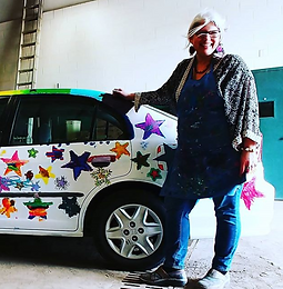 Funky star painted car and hippie artist