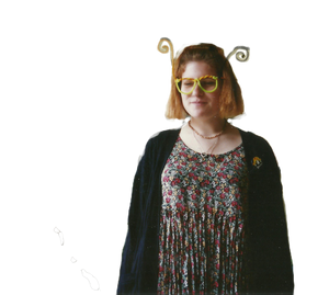 90's teenager with pipe-cleaner glasses, cardigan, and rayon floral dress