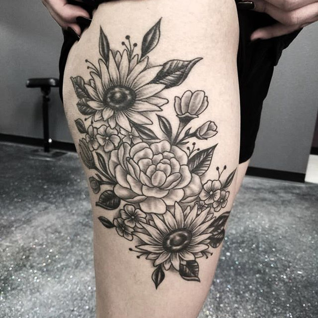 Healed floral tattoo by our artist Kevin