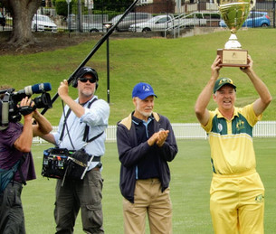 Victorious skipper Peter Solway lifts the World Cup, as Trevor Chappell applauds
