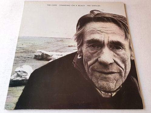 The Cure – Standing On A Beach • The Singles
