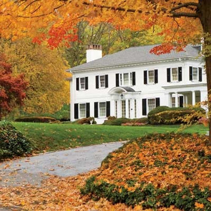 white-house-with-fall-trees.jpg