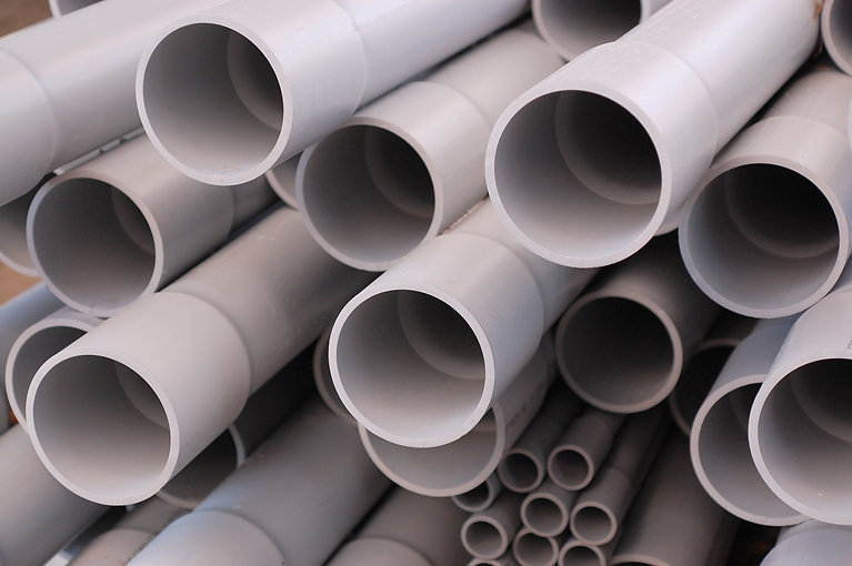 Close up ends of PVC conduit pipes on a