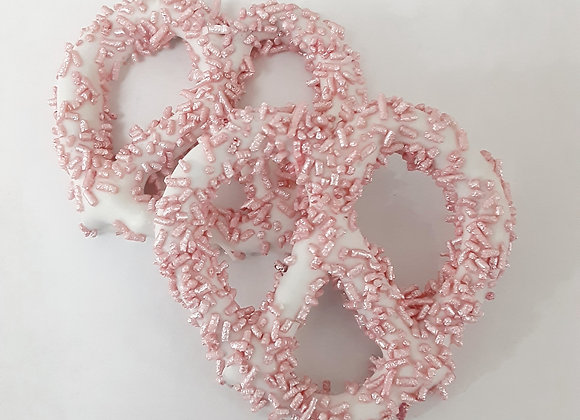 White chocolate covered pretzel with Pink Mettalic Sprinkels