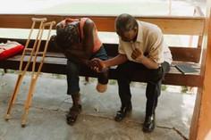 donald prays with Pastor Savine He gets