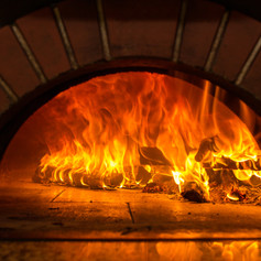 Fire wood burning in the oven.jpg