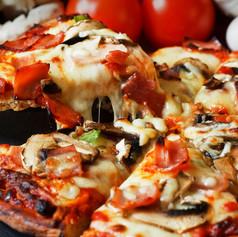 serving slice of ham and mushroom pizza