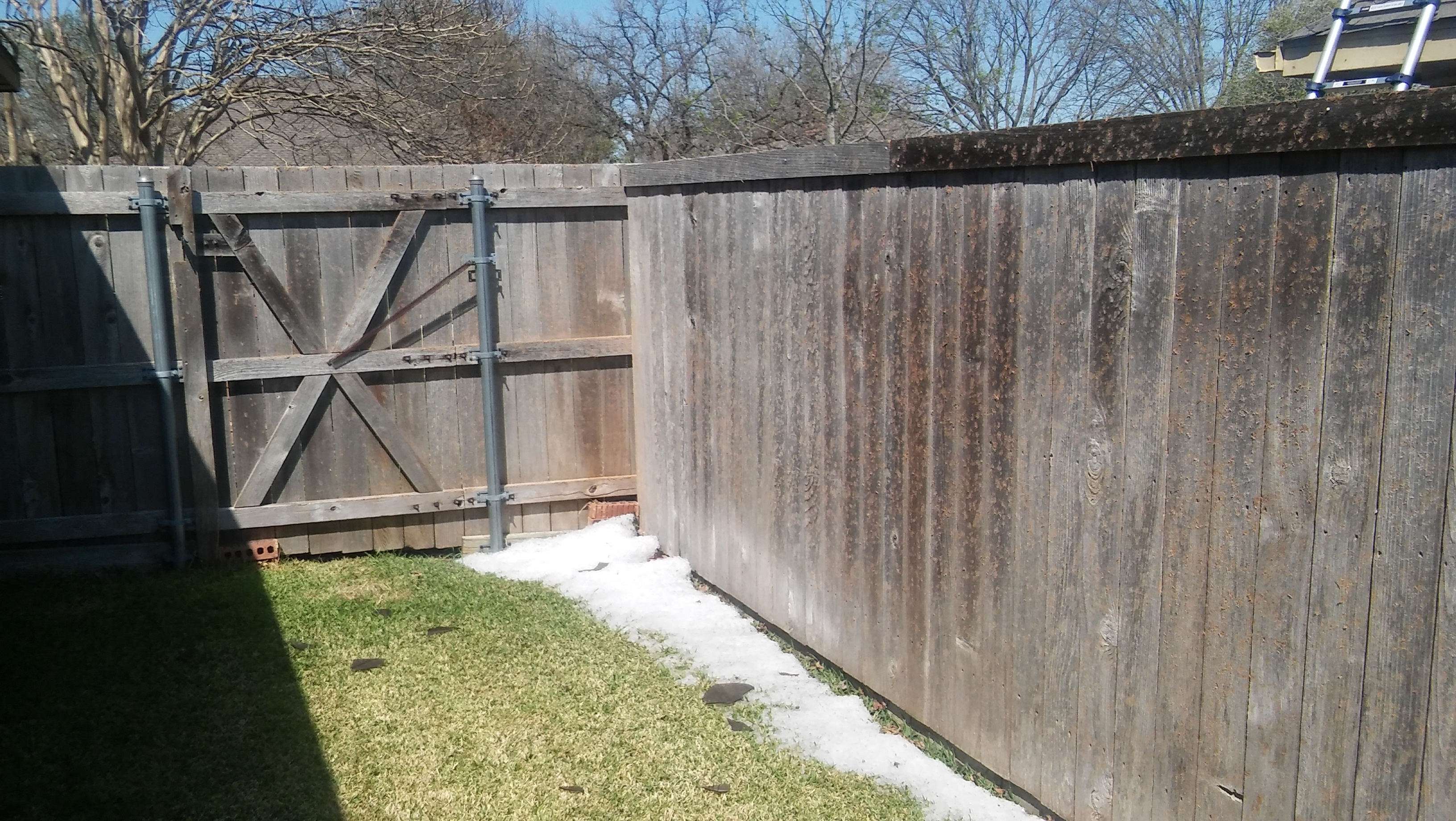 Hail Damaged Fence