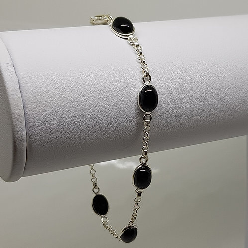 Cabochon cut black onyx silver bracelet