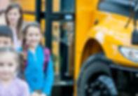Elementary school kids near a bus