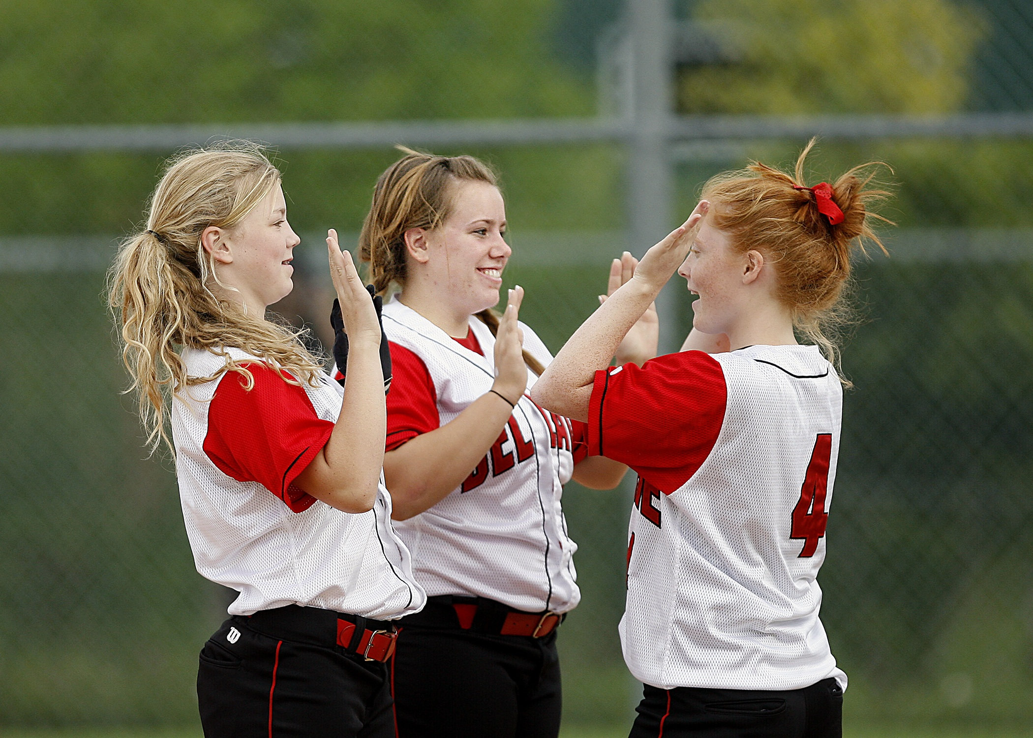 softball-girls-team-mates-happy-163465