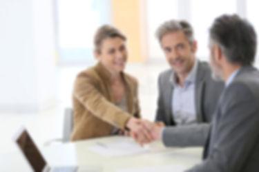 couple-banking-advisor-handshaking-bank-