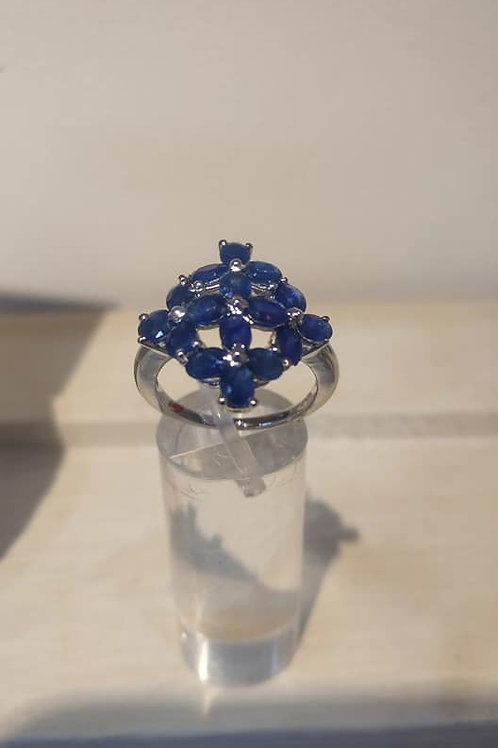 Sapphire flower inspired ring set in Sterling Silver