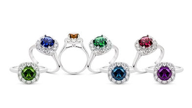 grouping of color gemstone rings with co
