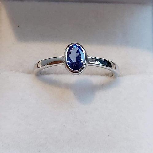 6 x 4 mm oval cut Tanzanite Bezel Set ring