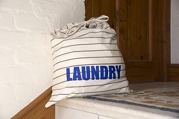 Laundry bag containing dirty washing awa
