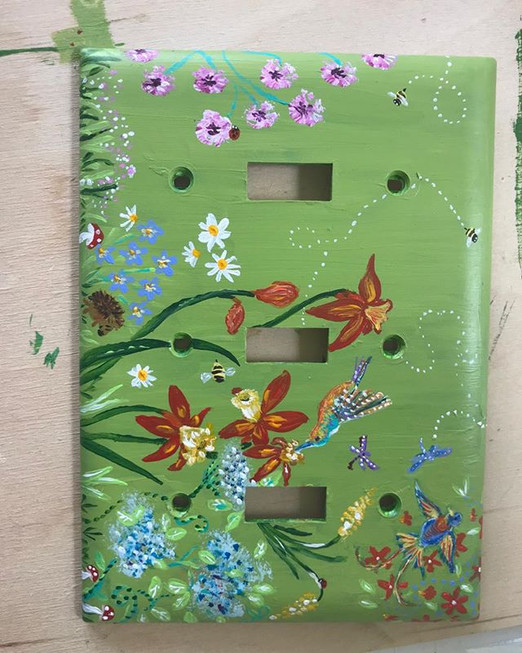 Commissioned light switch plate