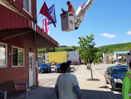 Flags Go Up on Main Street