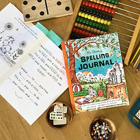 Fun-Schooling Spelling Journal workbook with an open book