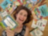 Sarah Janisse Brown smiling with Fun-Schooling workbooks surrounding her
