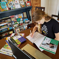 A 7th grade girl is homeschooling while working on Dyslexia Games Series C