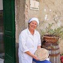 Corzano & Paterno's master cheese maker with the Buccia di Rospo cheese