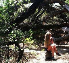 Erin sitting amongst the trees.jpg