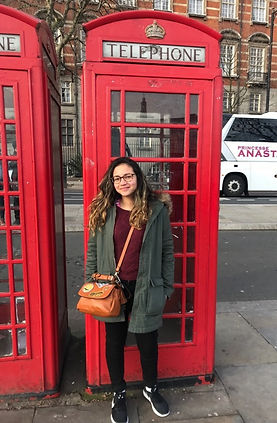 Student outside an English telephone booth