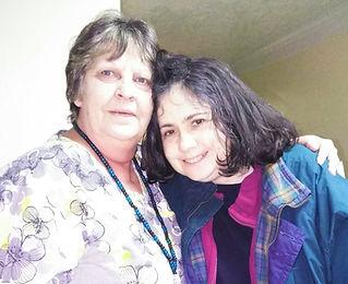 Caregiver hugging a Pinebrook resident.