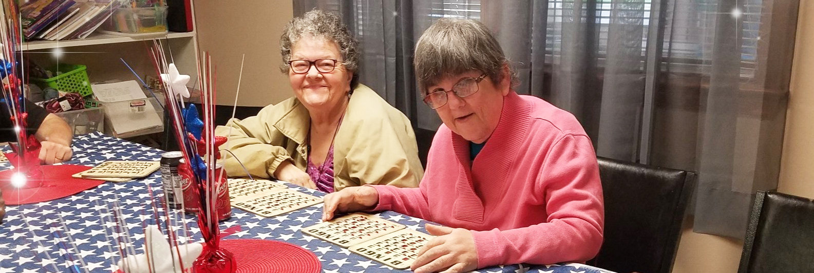 Two residents playing bingo together at Pinebrook