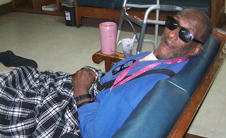 Resident relaxing in a lounge chair at Pinebrook