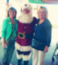 Renee and Margaret from Pelican Garden meet Santa