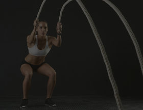 Woman%20with%20Fitness%20Ropes_edited.jp