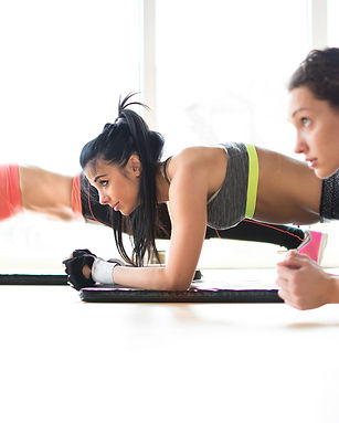 Three attractive sport girls doing plank